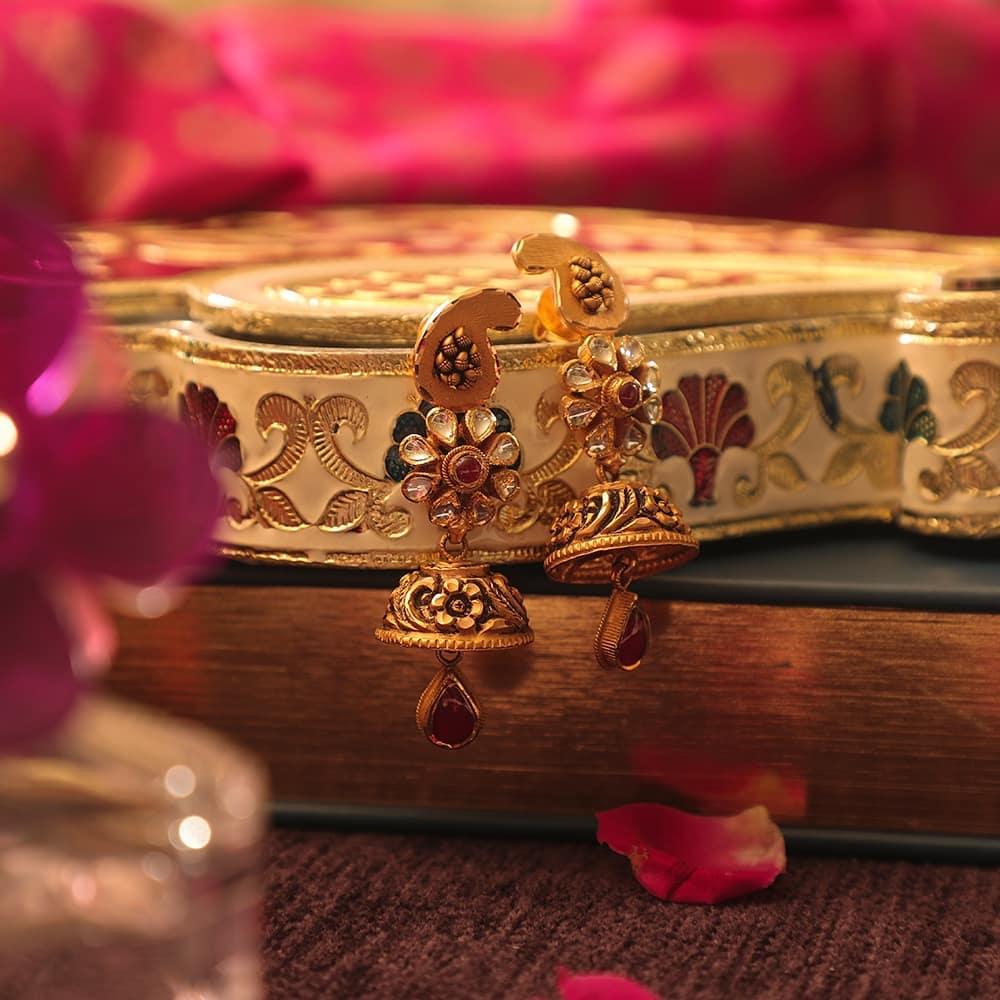 beautiful designs of gold jhumkas