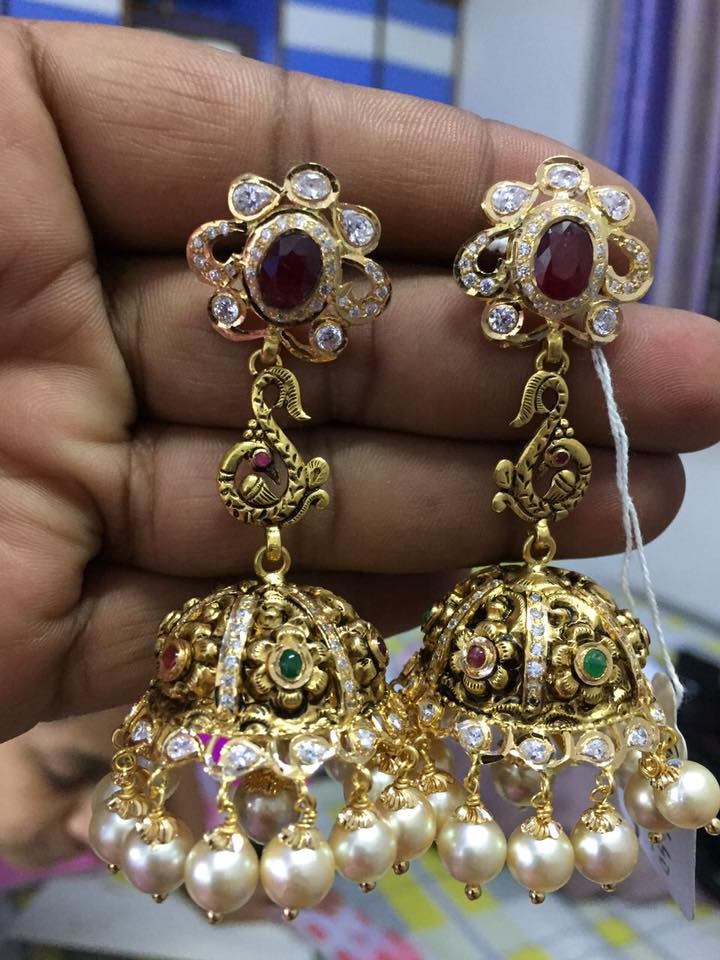 beautiful designs of gold jhumkas
